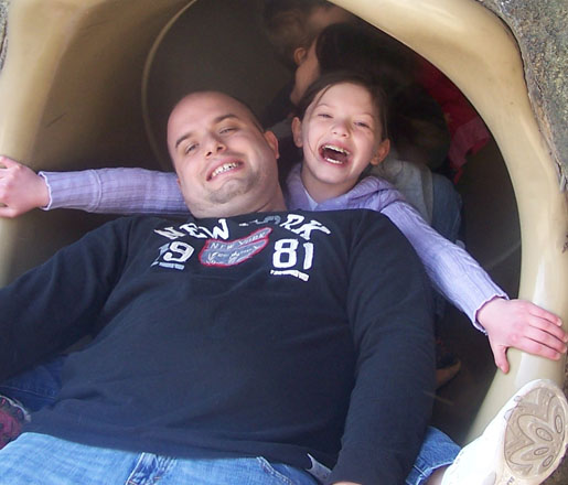 dad-daughter-coming-out-of-slide