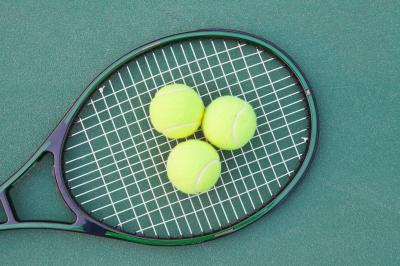 tennis racquet and balls
