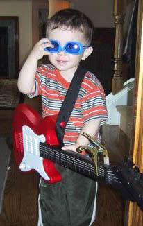 boy_guitar_sunglasses