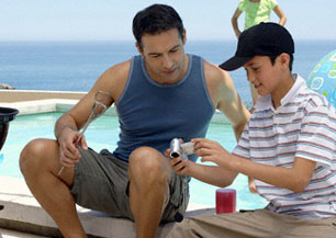 dad-teen-son-by-pool-bbq-camera