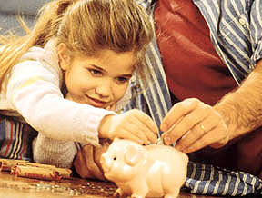 father-young-daughter-money-piggy-bank