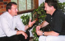2 men talking sm group