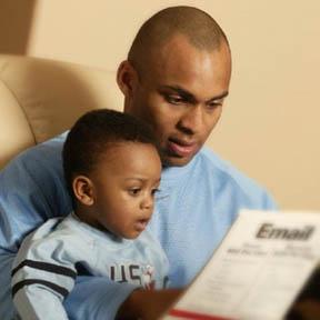 aa dad reading reading to preschool son
