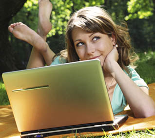 teen-girl-on-grass-with-computer