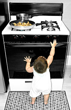 toddler-boy-reaching-for-stove