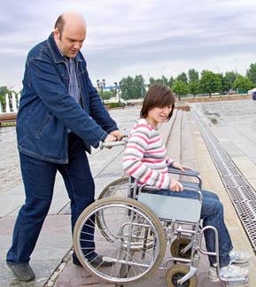 dad-pushing-teen-daughter-in-wheelchair