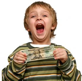 school-age-boy-holding-20-bill