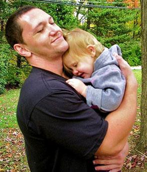 dad-hugging-preschool-daughter-outside