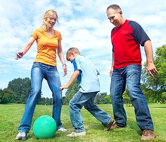dad-mom-school-age-son-soccer