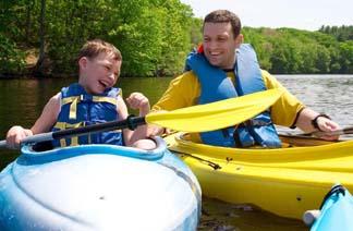 dad-school-age-son-kayaks