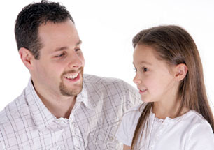 dad-school-age-daughter-talking-smiles