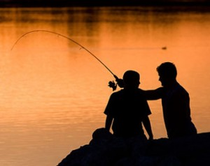 dad-teen-son-fishing-sunset-silhouette