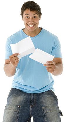 teen-boy-reading-letter-happy