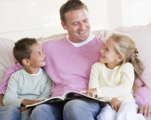 dad-2-school-age-kids-reading-couch