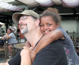 white-dad-aa-school-age-daughter-hug