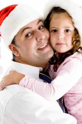 dad-hugging-preschool-daughter-Christmas-hats