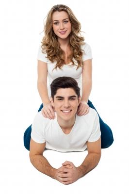 teen-couple-girl-sitting-on-guys-back