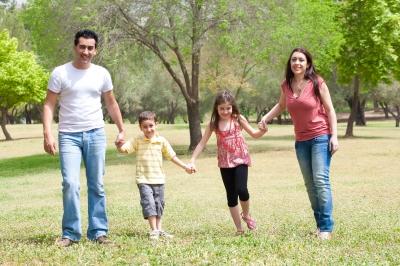 hisp-family-walking-in-field
