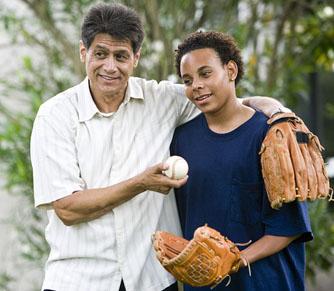 hisp-dad-teen-aa-son-arm-around-baseball