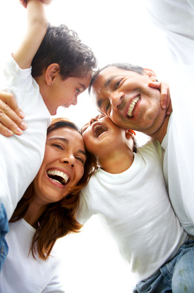 family lifestyle portrait of a mum and dad with their two kids