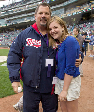 Perry FOY on field with daughter