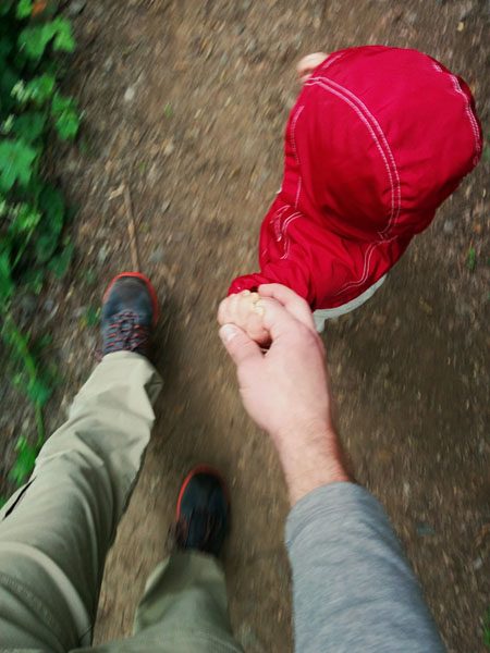 Dad-walking-with-preschooler-holding-hands-from-above
