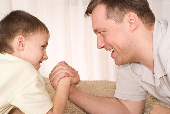 dad-school-age-son-arm-wrestle