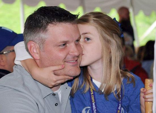 FOY dad school-age daughter kissing cheek