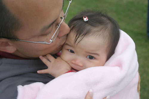 Asian-dad-kissing-infant-girl