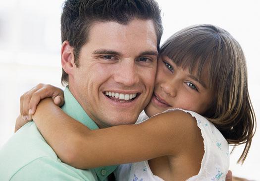 dad-school-age-daughter-close-hug-smiles