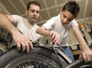 Father and son in garage